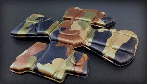Laminated and compression molded military helmet liner